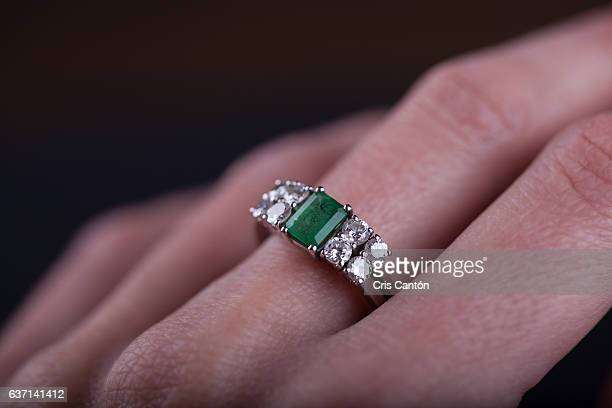 Emerald and diamond ring in finger