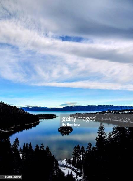 emerald bay lake tahoe blue sky cloud winter island - emerald bay lake tahoe stock pictures, royalty-free photos & images