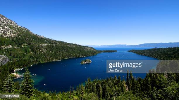 emerald bay surrounded with green trees under clear sky, lake tahoe, emerald bay state park, california, usa - emerald bay lake tahoe stock pictures, royalty-free photos & images