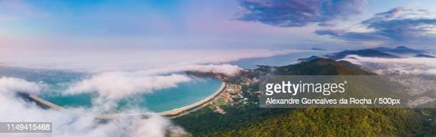 emerald coast under mist and fog - alexandre coste foto e immagini stock
