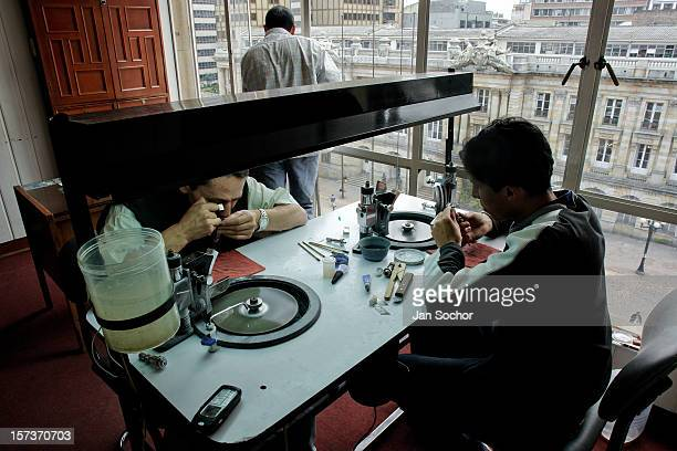 Emerald cutters cut and polish gemstones in their lapidary workshop in the centre of Bogota, Colombia, 31 March 2006. Despite of a persisting civil...