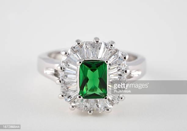 Emerald diamond ring on white background