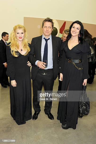 Emerald Fennell Hugh Grant and Coco Fennell attend the launch of Louise Fennell's debut novel Dead Rich at White Cube on February 8 2012 in London...