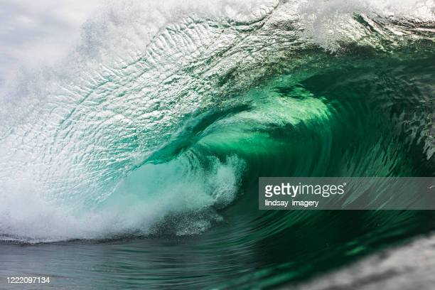emerald green wave breaking in the ocean - emerald green stock pictures, royalty-free photos & images