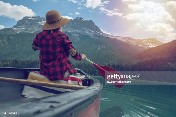 Emerald lake, Canada, Woman paddling canoe