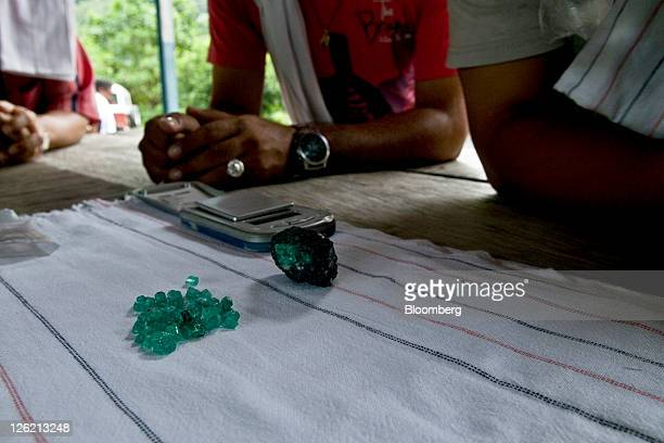 Emerald traders check the quality of freshly mined stones in Muzo Colombia on Friday Sept 16 2011 Colombia is the producer of the world's largest...