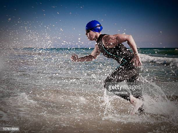 emerge - triathlon stock pictures, royalty-free photos & images