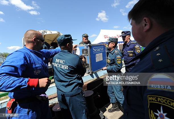 Emergencies Ministry divers from the Black Sea port of Tuapse prepare on July 11 2011 their diving equipment on a bank of the Volga River near the...