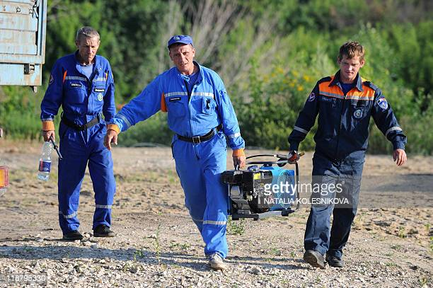 Emergencies Ministry rescuers prepare on July 11 2011 their equipment on a bank of the Volga River near the village of Kamskoye Ustye some 130 kms...