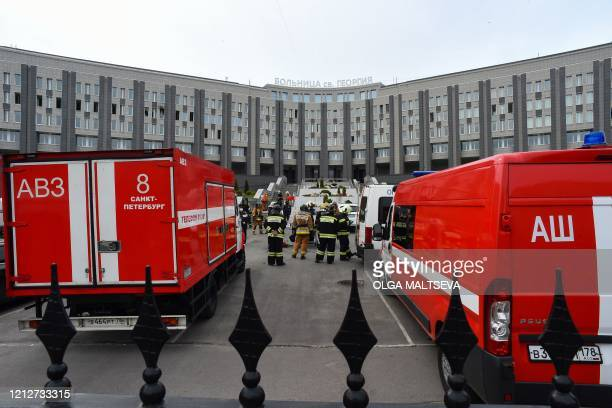 Emergencies personnel work at the site of a fire at the Saint George hospital in Saint Petersburg on May 12, 2020. - A fire at a hospital in Russia's...
