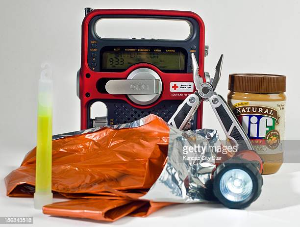 Emergencies supplies including a glow stick an emergency blanket a flashlight pent butter multipurpose tool and radio make for a survival kit that...