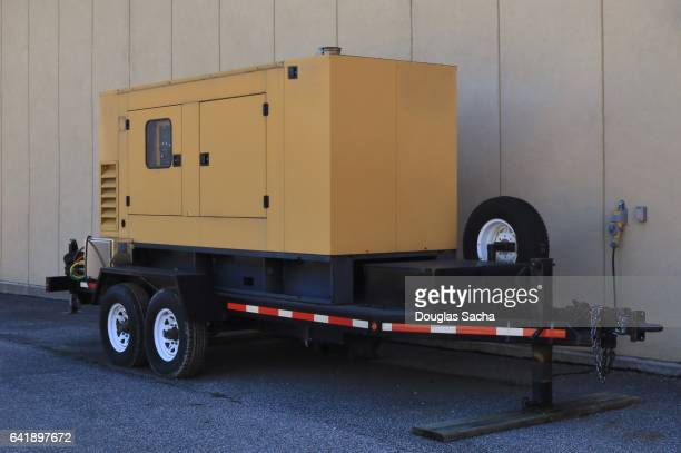 emergency backup electric generator on a moveable trailer - generator stock pictures, royalty-free photos & images