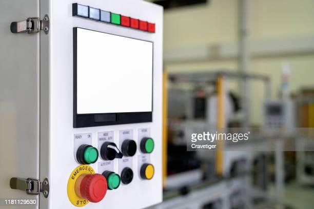 emergency button on the control panel in the manufacturing process. - sinal de emergência informação imagens e fotografias de stock