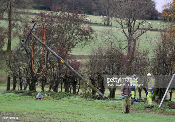 Emergency crew from NI Networks working on a fallen electricity poll in Doagh Ballyclare after Hurricane Ophelia battered the UK and Ireland with...