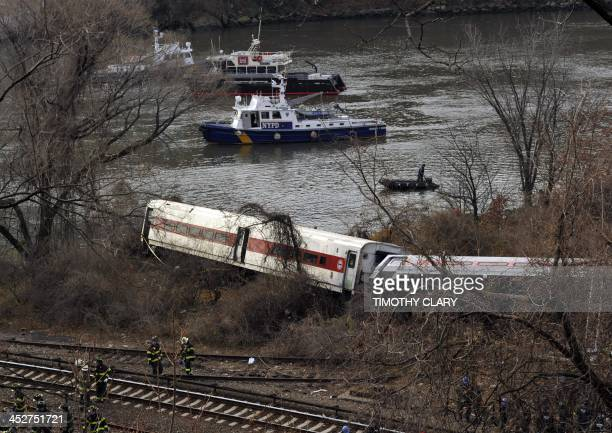 Emergency crews at the scene of a commuter train wreck on Dec 1 2013 in the Bronx borough of New York The train bound for New York's Grand Central...