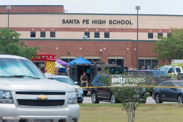 Emergency crews gather in the parking lot of Santa Fe High School where at least eight people were killed on May 18 2018 in Santa Fe Texas At least...