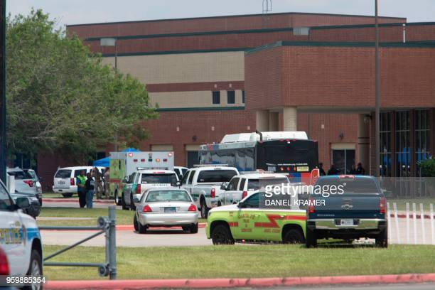 TOPSHOT Emergency crews gather in the parking lot of Santa Fe High School where at least eight people were killed on May 18 2018 in Santa Fe Texas At...