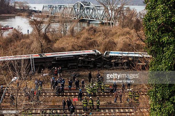 Emergency crews help injured passengers after MetroNorth train derailed near the Spuyten Duyvil station December 1 2013 in the Bronx borough of New...