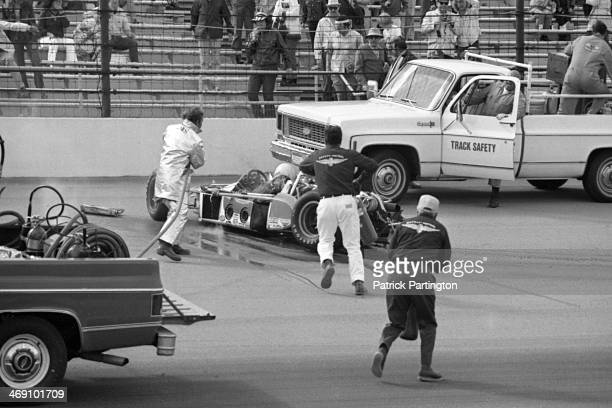 Emergency crews rush to the aid of American driver Art Pollard whose fatal crash occurred during a practice race for the Indianapolis 500...