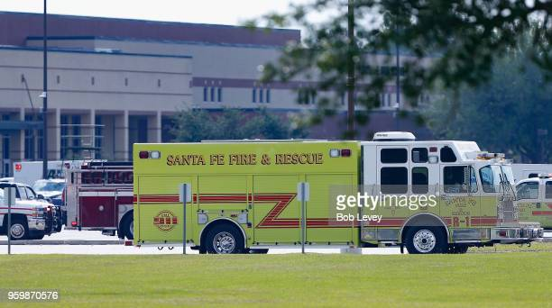 Emergency crews stage in the parking lot of Santa Fe High School where at least 10 students were killed on May 18 2018 in Santa Fe Texas At least 10...