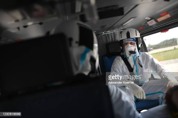 Emergency doctor Martin Fleiderer, crew member of the DRF Luftrettung emergency air medical services arrives with a Covid-19 patient at Charite...