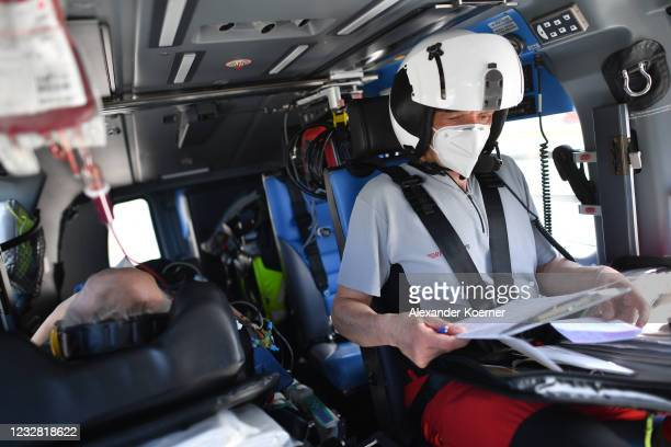 Emergency doctor Martin Fleiderer, crew member of the DRF Luftrettung emergency air medical services arrives with a patient at Charite hospital...