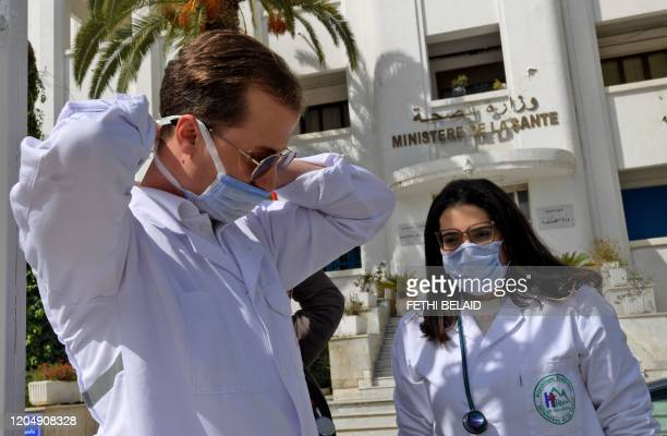 Emergency doctors and nurses from Tunisia's Ben Arous state, who have been trained to handle COVID-19 coronavirus disease cases, exit the Tunisian...