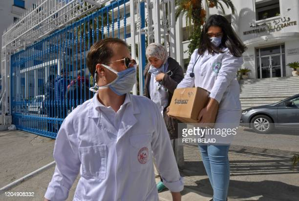 Emergency doctors and nurses from Tunisia's Ben Arous state who have been trained to handle COVID19 coronavirus disease cases exit the Tunisian...