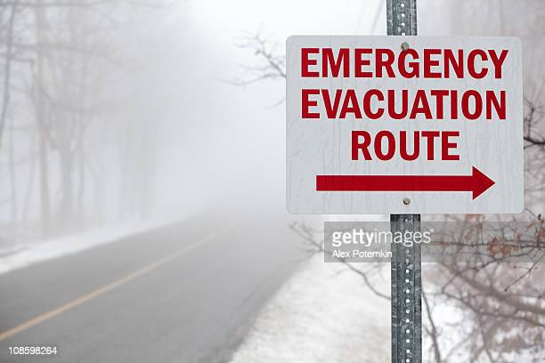 """""""emergency evacuation route"""" sign on the mist road - evacuation stock pictures, royalty-free photos & images"""
