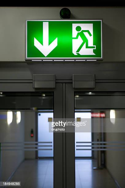 emergency exit light sign - exit sign stock pictures, royalty-free photos & images