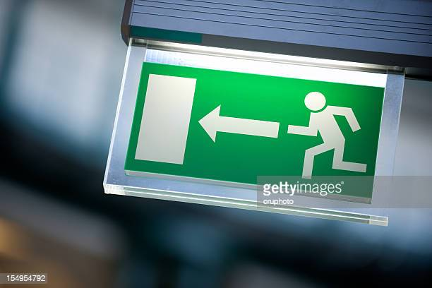 emergency exit sign in white and green - exit sign stock pictures, royalty-free photos & images