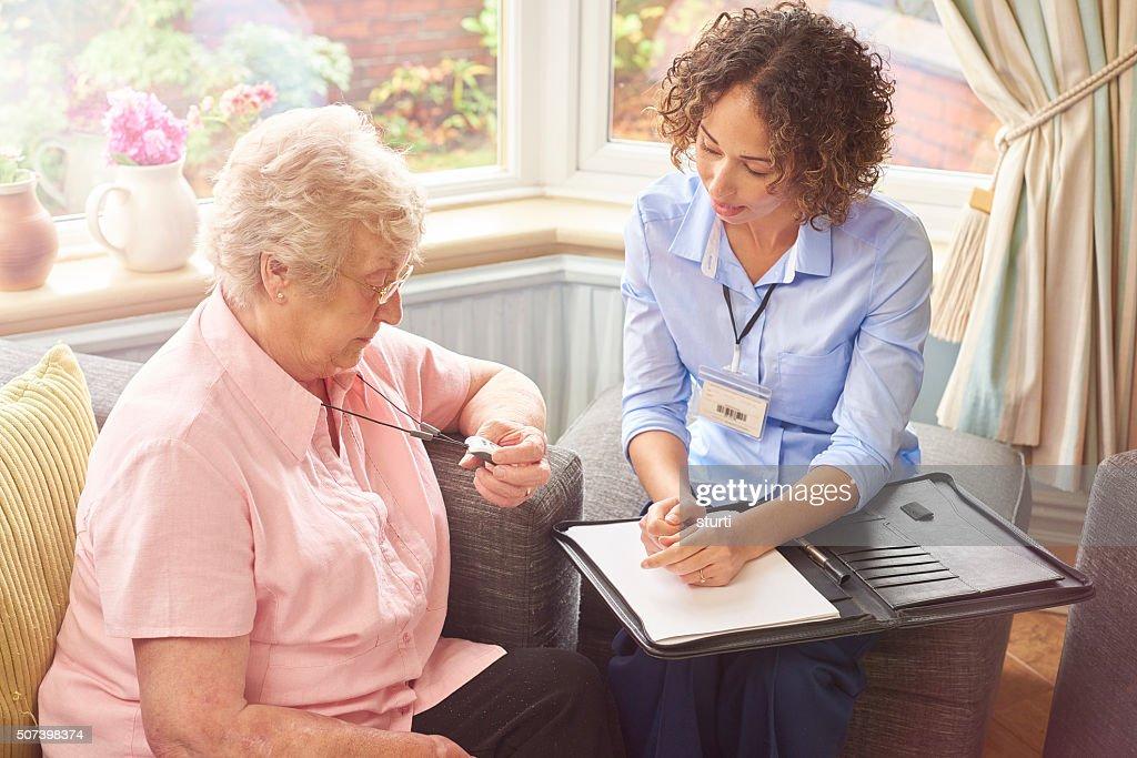 emergency fall button for senior woman : Stock Photo