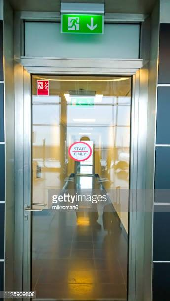 emergency fire doors in the airport. staff only sign - exit sign stock pictures, royalty-free photos & images