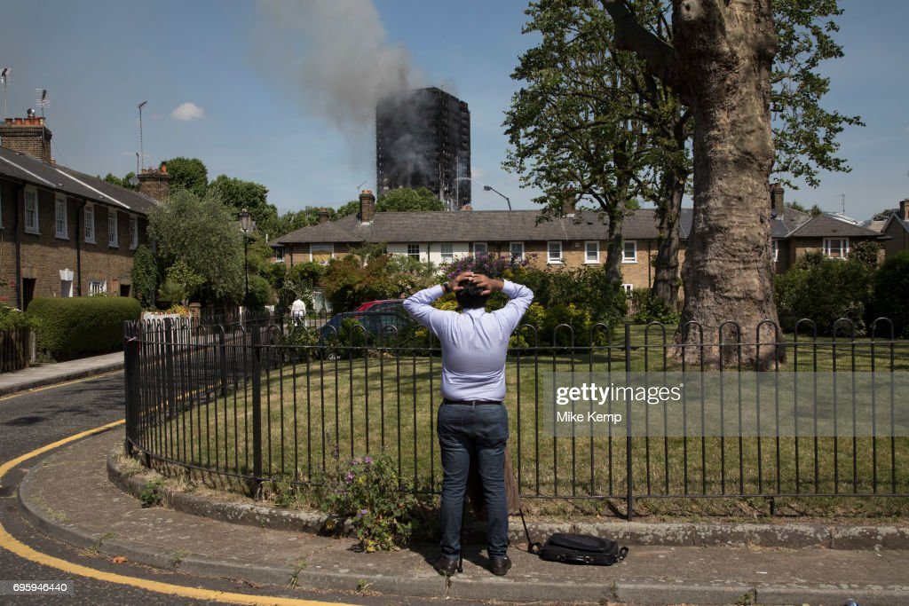 Emergency fire services tackle a blaze at Grenfell Tower near Notting Hill on 14th June 2017 in West London, United Kingdom. The huge fire engulfed the tower block, trapping many people in their homes. A number of fatalities are reported. The block of flats in the Borough of Kensington and Chelsea,billowed large plumes of smoke way above the capital after the blaze broke out in the early hours of Wednesday morning. Londoners came out on the streets to help, offer food and water, support and assistance to those who had lost their homes or didnt know the whereabouts of their friends and family.