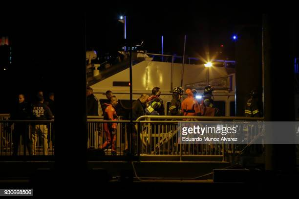Emergency first responders attend a call after a helicopter crashed in the East River on March 11 2018 in New York City According to reports at least...