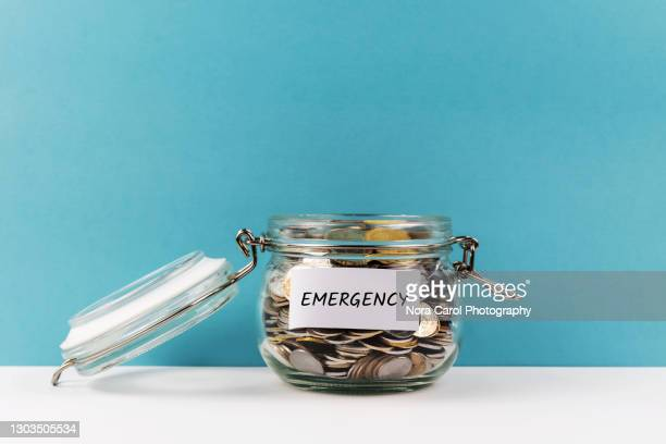 emergency fund coin jar - emergencies and disasters stock pictures, royalty-free photos & images
