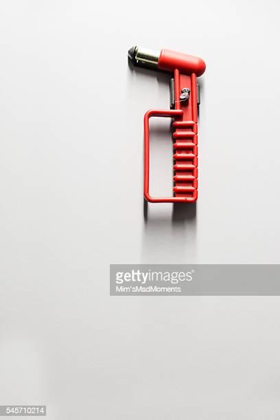 Emergency hammer on wall