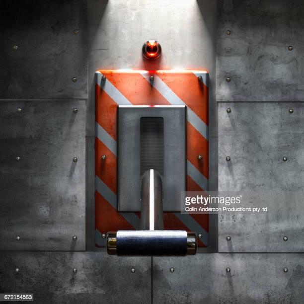 Emergency handle on metal wall