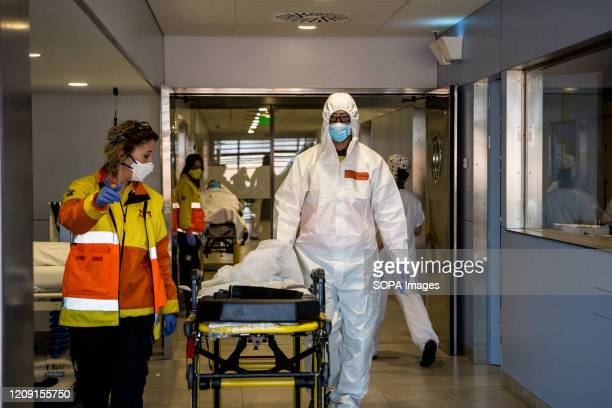 Emergency health workers in protective gear as a preventive measure finalising a transfer of a possible case of covid19 The emergency health services...