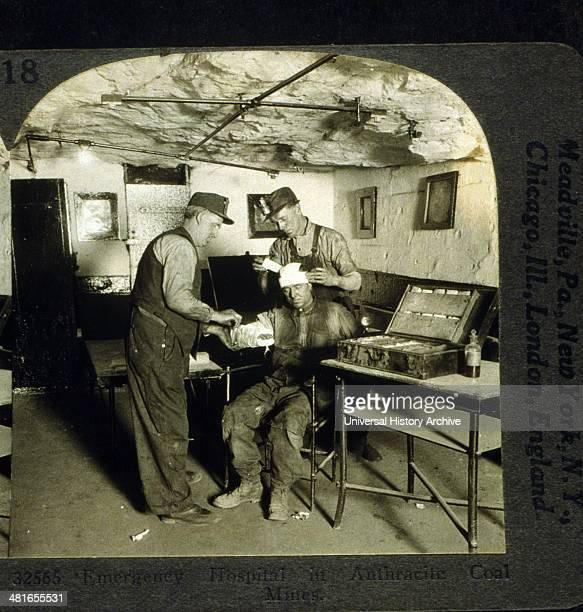Emergency hospital in anthracite coal mines photographic print on stereo card or stereograph One man bandages head of injured man while another...