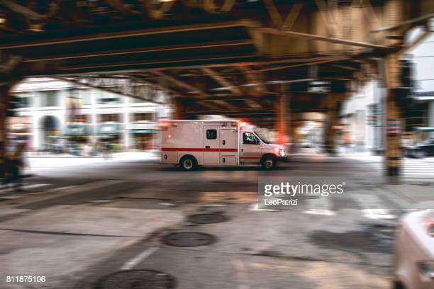 emergency in downtown chicago - ambulance stock pictures, royalty-free photos & images