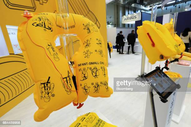 Emergency life vests manufactured by EAM Worldwide sit on display at the Aircraft Interiors Expo in Hamburg, Germany, on Tuesday, April 4, 2017....