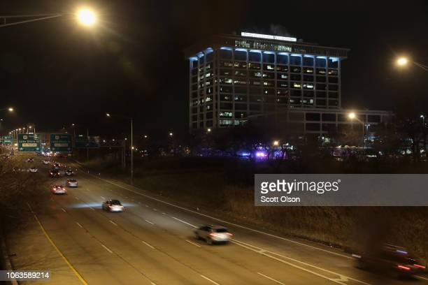Emergency lights flash in front of Mercy Hospital as police secure the scene after a gunman opened fire on November 19 2018 in Chicago Illinois A...