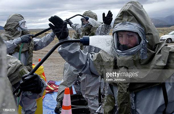 Emergency Management personnel go through decontamination during an exercise simulating an accidental release of chemical agent from the Deseret...