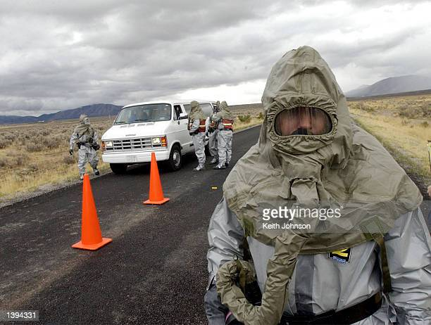 Emergency Management personnel monitor a road during an exercise simulating an accidental release of chemical agent from the Deseret Chemical Depot...