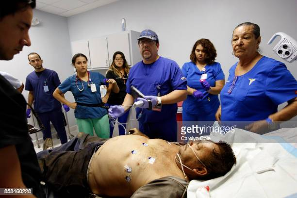 Emergency MD Alfredo Tirado center and MD Julian Trevino far left from Florida Hospital in Orlando tend to an emergency case of Hilberto Torres...