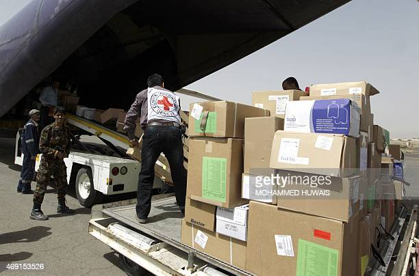 Emergency medical aid from the International Committee of the Red Cross is unloaded from a plane at the Sanaa international airport on April 10 2015...