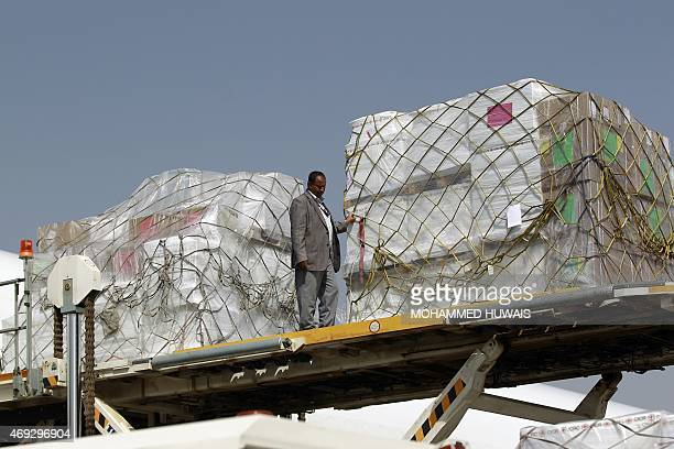 Emergency medical aid from the International Committee of the Red Cross is unloaded from a plane at the international airport in Sanaa on April 11...