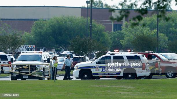 Emergency medical personnel stage in the Santa Fe High School parking lot where 10 students were shot and killed on May 18 2018 in Santa Fe Texas At...