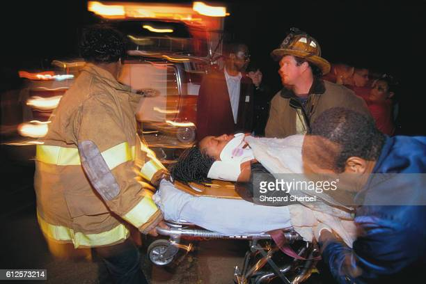Emergency Medical Service and fire department help at a car accident on highway 2 in Washington DC The wreck injured the drunk driver and his...